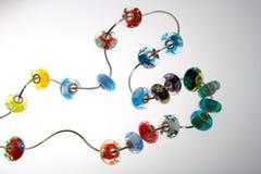 Perle di vetro su collegare Fotografie Stock