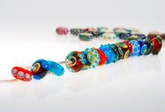 Perle di vetro su una catena Fotografia Stock Libera da Diritti