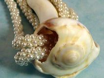 Perle e coperture fotografia stock