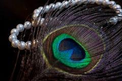 Perle e piuma del pavone Immagini Stock Libere da Diritti