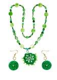 Perle ed orecchini da plastica, legno, vetro del filato Fotografie Stock