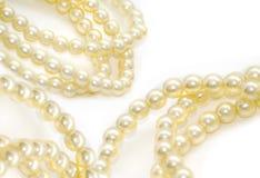 Perle isolate su bianco Fotografie Stock