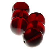 Perle rosse su un fondo bianco Immagine Stock Libera da Diritti