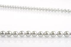 Perle su bianco Immagini Stock Libere da Diritti