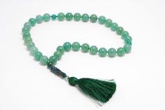 Perle verdi del rosario, dalla gemma Immagini Stock