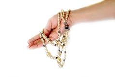 Perlen in der Hand Lizenzfreies Stockbild