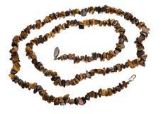 Perlen des Tigerauges, lokalisiert Lizenzfreies Stockbild