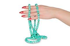 Perlen an Hand Lizenzfreie Stockbilder