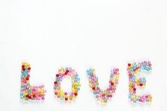 Perles colorées pour l'amour de fond Photographie stock libre de droits