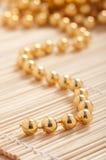 Perles d'or image libre de droits