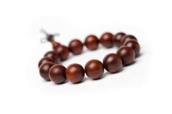 Perles de bois de santal rouge Photographie stock