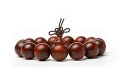 Perles de bois de santal rouge Photographie stock libre de droits