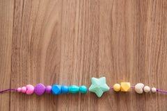 Perles du silicone de la fille colorée Photo stock