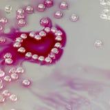 Perles en forme de coeur Image stock