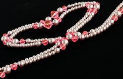 Perles en forme de coeur Photos libres de droits