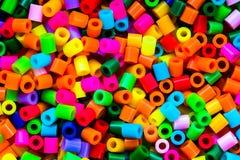 Perles en plastique colorées - puzzle thermo Photo stock