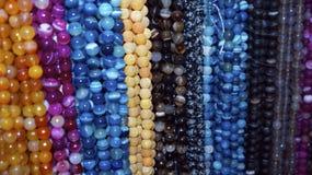 Perles en verre d'orange, pourpres et bleues Image stock