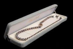 Perles noires images stock