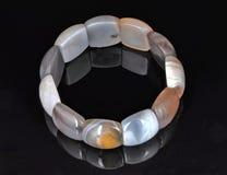 Perles plates de bracelet Photos libres de droits
