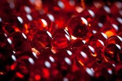 Perles rouges de gel Photo stock
