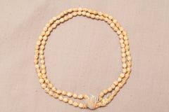 Perles roulées de chant de mala de japa Photographie stock