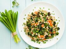 Perlotto. Boiled pearl barley with nettle, carrot and leek. Shallow dof Stock Photos