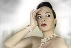 Perls 3. Young beautiful woman with pearls Royalty Free Stock Image