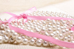 Perls and ribbon. On canvas (close up Stock Image