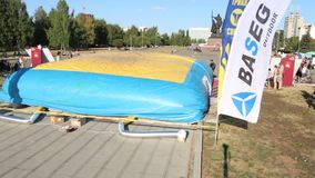 PERM, RUSSIA - AUG 20, 2016: Extreme bicyclist jumps into big air bag during aeromat jumps championship of Perm region stock video footage