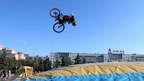 PERM, RUSSIA - AUG 20, 2016: Extreme cyclist jumps into Big Air Bag during Aeromat jumps championship of Perm region stock video footage