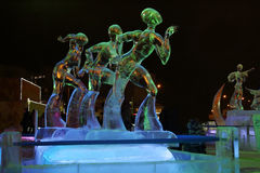 PERM, RUSSIA - JAN 11, 2014: Illuminated sculpture figure. Skating at evening in Ice town, created in honor of Winter Olympic Games 2014 will be in Sochi Stock Photo