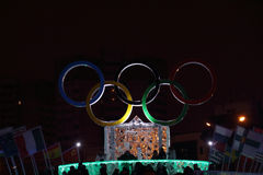 PERM, RUSSIA - JAN 11, 2014: Illuminated symbol of Olympic Games. In Ice town at evening, created in honor of Winter Olympic Games 2014 will be in Sochi, Russia Royalty Free Stock Image