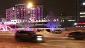 PERM, RUSSIA - JAN 10, 2017: Cars move down Lenin street during blizzard at winter evening stock video