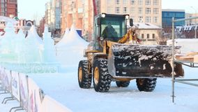 PERM, RUSSIA - JAN 18, 2017: Tractor works in Ice town, Perm Ice Town 2017 Ekosad - largest in Russia stock video footage