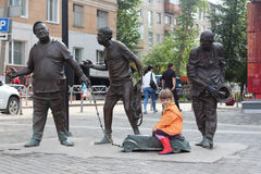 PERM, RUSSIA - JUL 18, 2013: City sculpture is dedicated to famous characters of film Caucasian captive. PERM, RUSSIA - JUL 18, 2013: Little girl near city Royalty Free Stock Image