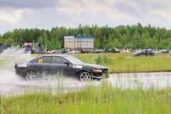 PERM, RUSSIA - JUL 22, 2017: Drifting black car on track Royalty Free Stock Image