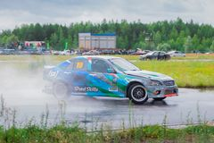 PERM, RUSSIA - JUL 22, 2017: Drifting car move on wet asphalt Royalty Free Stock Images