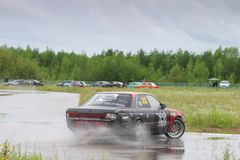 PERM, RUSSIA - JUL 22, 2017: Drifting car in puddle Royalty Free Stock Image