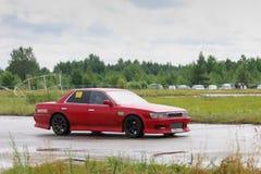 PERM, RUSSIA - JUL 22, 2017: Drifting red car on asphalt track Stock Photos
