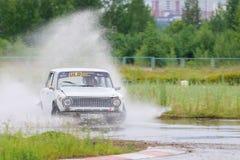PERM, RUSSIA - JUL 22, 2017: Drifting white car with splash Royalty Free Stock Photo