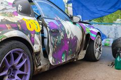 PERM, RUSSIA - JUL 22, 2017: Part of sport car with graffiti Royalty Free Stock Photography