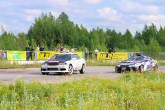 PERM, RUSSIA - JUL 22, 2017: Two drifting cars compete. On track Open Ural Championship Drift 2017 stock images