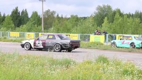 Perm, Russia - Jul 22, 2017: two drifting cars on track stock video footage