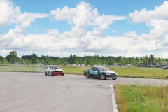 PERM, RUSSIA - JUL 22, 2017: Two drifting cars on track. Open Ural Championship Drift 2017 royalty free stock images