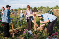 Perm, Russia - July 13.2016: Elderly people care for the graves Stock Photo