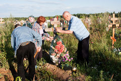 Perm, Russia - July 13.2016: Elderly people care for the graves Royalty Free Stock Photos