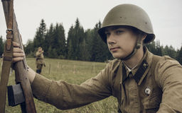 PERM, RUSSIA - JULY 30, 2016: Historical reenactment of World War II, summer, 1942. Soviet soldier with rifle Stock Photography