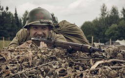 PERM, RUSSIA - JULY 30, 2016: Historical reenactment of World War II, summer, 1942. Soviet soldier with rifle Royalty Free Stock Photos