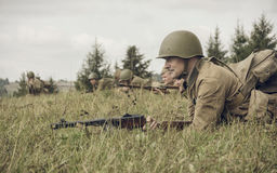 PERM, RUSSIA - JULY 30, 2016: Historical reenactment of World War II, summer, 1942. Soviet soldier with rifle.  Stock Images