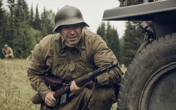 PERM, RUSSIA - JULY 30, 2016: Historical reenactment of World War II, summer, 1942. Soviet soldier with rifle Royalty Free Stock Photography